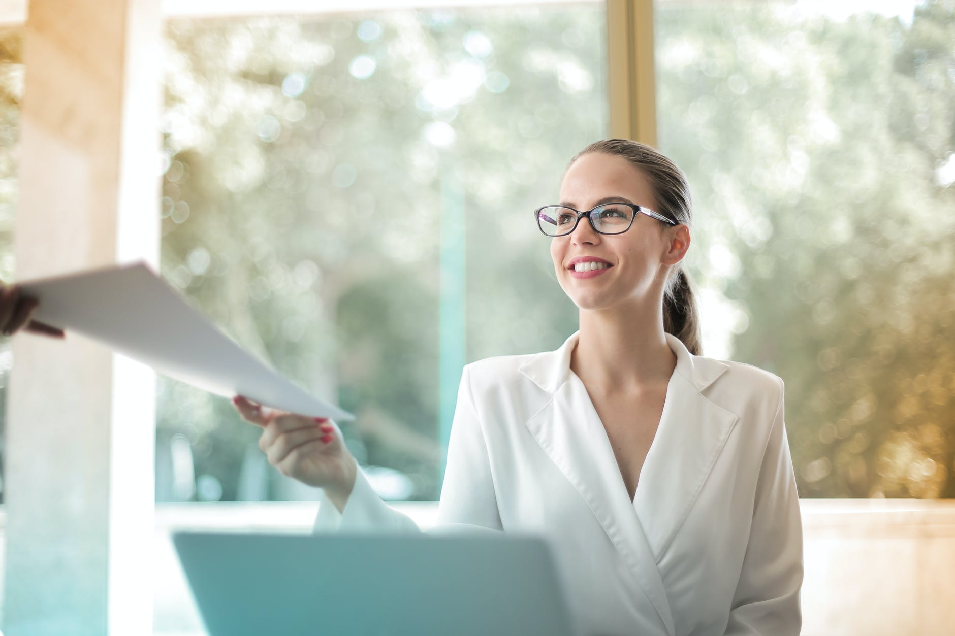 positive businesswoman doing paperwork in office